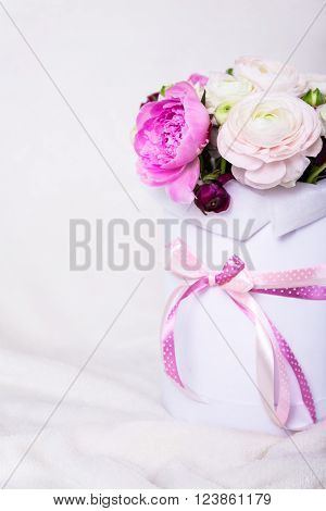 Close Up Of Big Bunch Of Beautiful Summer Flowers In Round Cardboard Box Over White