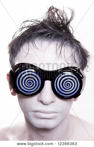Young Man With White Skin In Strange Blue Glasses