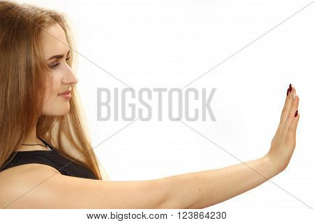 young nice girl considers manicure. a portrait on a white background