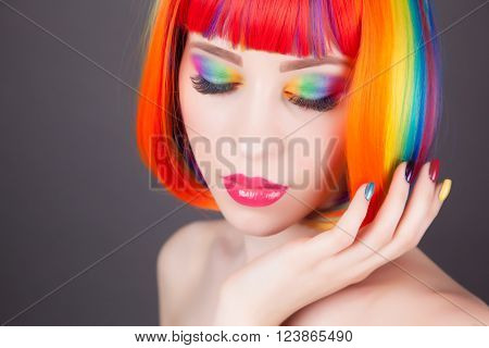 Beautiful Woman Wearing Colorful Wig And Showing Colorful Nails