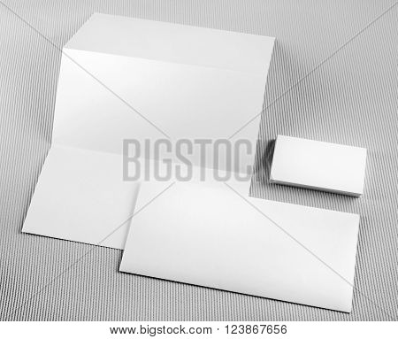 Photo of blank stationery set on gray background. Template for design presentations and portfolios. Mock-up for branding identity. Template for ID.