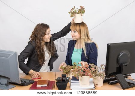 Frustrated Office Employee Puts On A Head-grower Colleagues With A Flower Pot