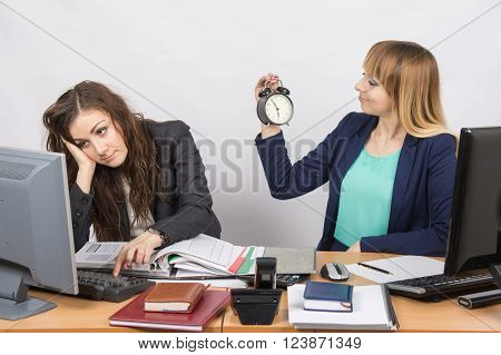 Waiting For The End Of Working Hours By Two Employees Of The Office