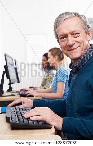 Portrait Of Mature Man Attending Computer Training Class