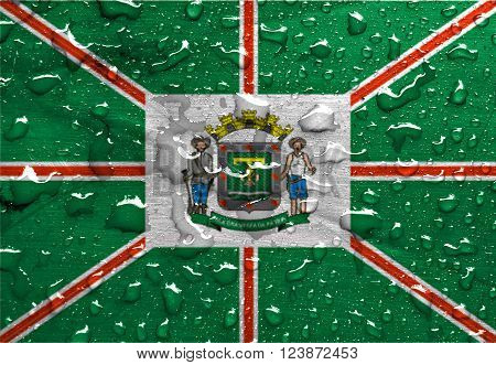 a flag of Goiania with rain drops