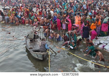 ALLAHABAD, INDIA - FEBRUARY 12, 2013: Thousands of Hindu devotees come to confluence of the Ganges and Yamuna River for holy dip during the festival Kumbh Mela. The world's largest religious gathering