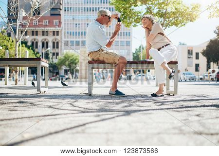 Mature Couple Photographing Each Other
