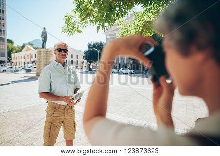 Senior Tourist Posing For Photograph