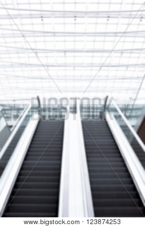 escalator in very bright office building as an image background texture blurred