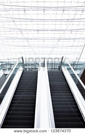 escalator in very bright office building as an image background texture
