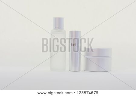 group of serum bottles on white backgrounds.