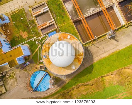 Aerial view to biogas plant and sewage treatment. Renewable energy from biomass. Industrial background.
