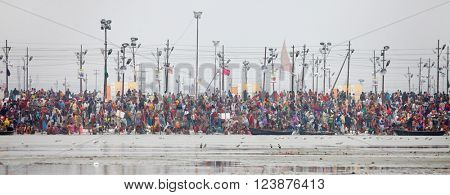 ALLAHABAD, INDIA - FEBRUARY 07, 2013: Thousands of Hindu devotees come to confluence of Ganges and Yamuna River for holy dip during the festival Kumbh Mela. The world's largest religious gathering