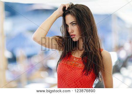 Immaculate fashion model beautiful woman posing outdoors