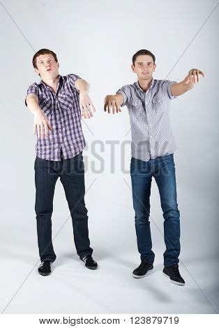 photo of two funny boys fooling around