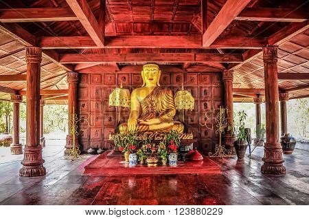 The budda Asian style in an ancient temple.