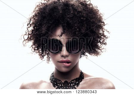 Beauty closeup portait of young  african american girl with afro. Ideal skin.
