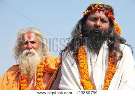 ALLAHABAD, INDIA - FEBRUARY 10, 2013: two unidentified sadhu (holy man) at the Maha Kumbh Mela Hindu religious festival