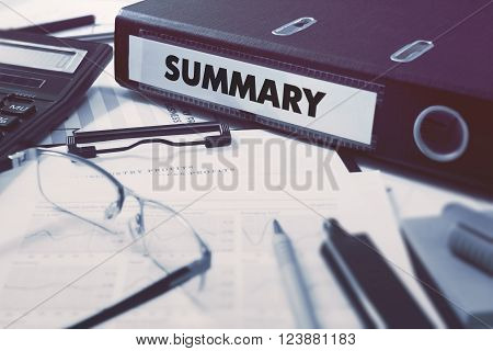 Ring Binder with inscription Summary on Background of Working Table with Office Supplies, Glasses, Reports. Toned Illustration. Business Concept on Blurred Background.