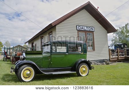 DALTON, MINNESOTA, Sept 10, 2015: A 1928 Model T Ford is parked in from of the Dalton train station at the annual Dalton Steam Threshers Reunion held the 2nd weekend of September when 1,000s attend.