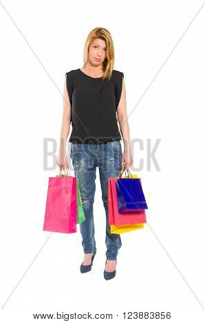 Sad and dissapointed shopping woman standing isolated on white backrgound