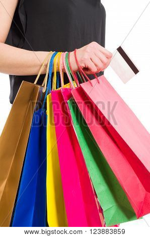 Woman Hand Holding Shopping Bags And Credit Or Debit Card