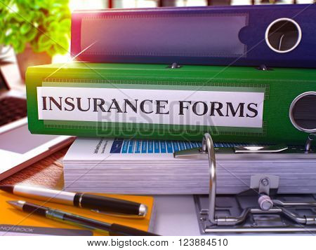 Insurance Forms - Green Ring Binder on Office Desktop with Office Supplies and Modern Laptop. Insurance Forms Business Concept on Blurred Background. Insurance Forms - Toned Illustration. 3D Render.