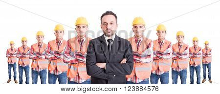 Confindent business man and a team of construction workers. Wide image of boss or leader concept