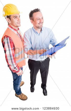 Happy contractor and construction worker holding clipboard