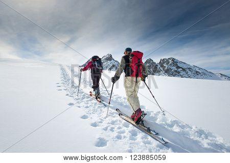Two Elderly Alpine Skiers