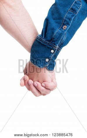 Men holding hands as homosexual couple. Gay pride or lgbt liberty and tolerance concept