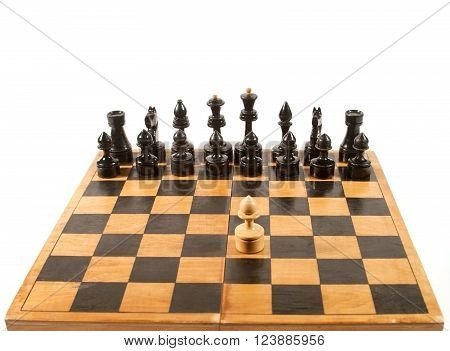 Rows of black chess figures and a single white pawn on the chessboard (isolated on white with copy space for your text)