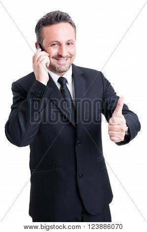 Business Man Talks On The Phone And Shows Thumb Up
