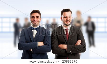 Business people standing confindent with arms crossed on corporate background