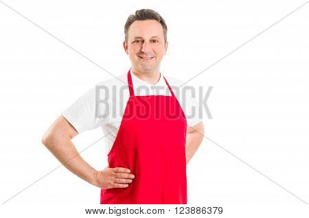 Confident and successful hypermarket worker wearing red apron