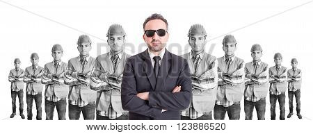 Business man leader of builders or construction workers on wide imag