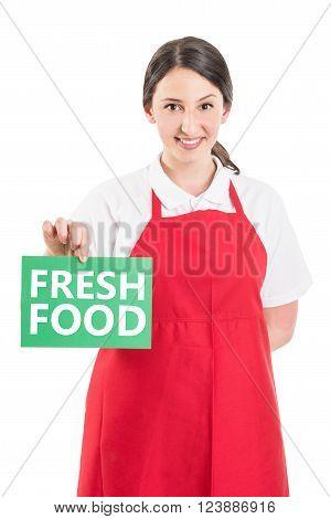 Female Hypermarket Worker Holding Fresh Food Sign