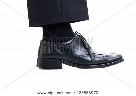 Classic black suit pants sock and leather shoe isolated on white background. Business manager foot concept