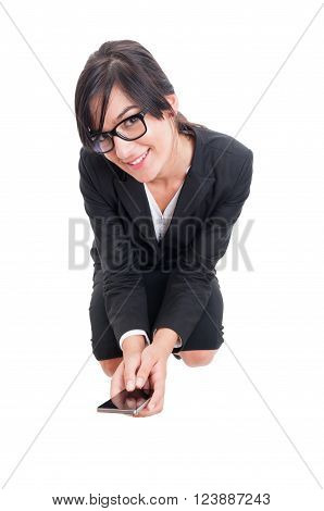 Business Woman Sitting On Crouches And Holding Smartphone