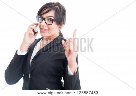 Saleswoman Talking On The Phone And Making Wait Gesture