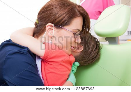 Dentist Woman Hugging Child Patient