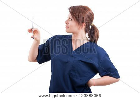 Confident Female Doctor Holding Syringe With Anesthetic