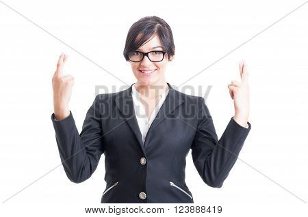 Business woman wishing for luck with crossed fingers. Good luck with cross fingers concept