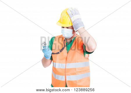 Confused doctor or medic wearing builder clothes as vest and helmet