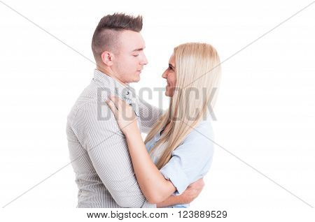 Happy young couple hugging and looking at each other or into eachother eyes