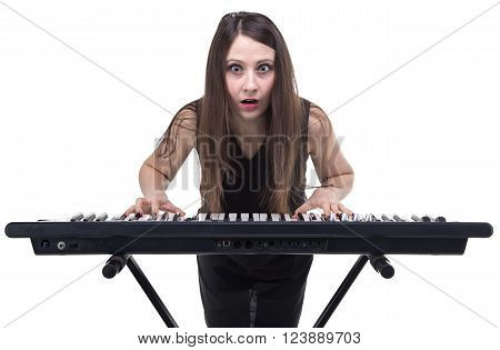 Surprised woman with synthesizer on white background