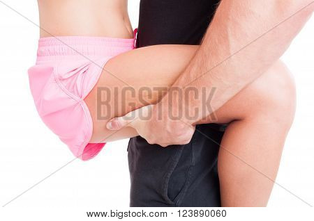 Close Up With Man Hand Holding Woman Leg