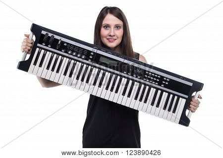 Young woman holding synthesizer on white background