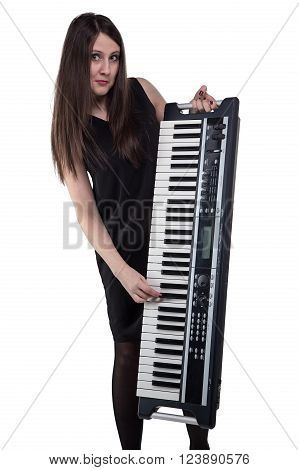 Young woman with synthesizer on white background
