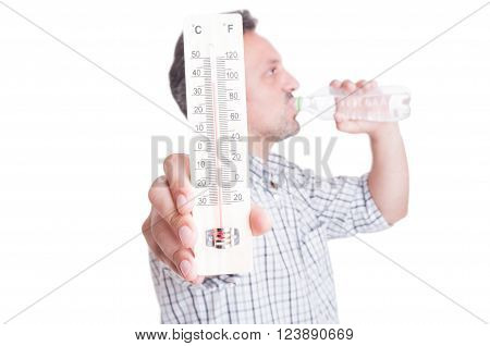 Man holding thermometer and drinking cold water. Summer heat and dehydration concept isolated on white